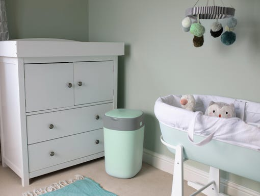 green-nursery-with-green-twist-and-click-and-sleepee-basket