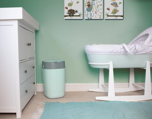 twist-and-click-in-green-in-nursery-standing-next-to-green-sleepee-basket