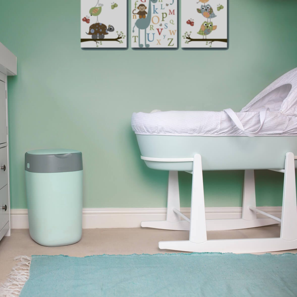 green-twist-and-click-nappy-bin-in-green-nursery-next-to-green-sleepee-basket