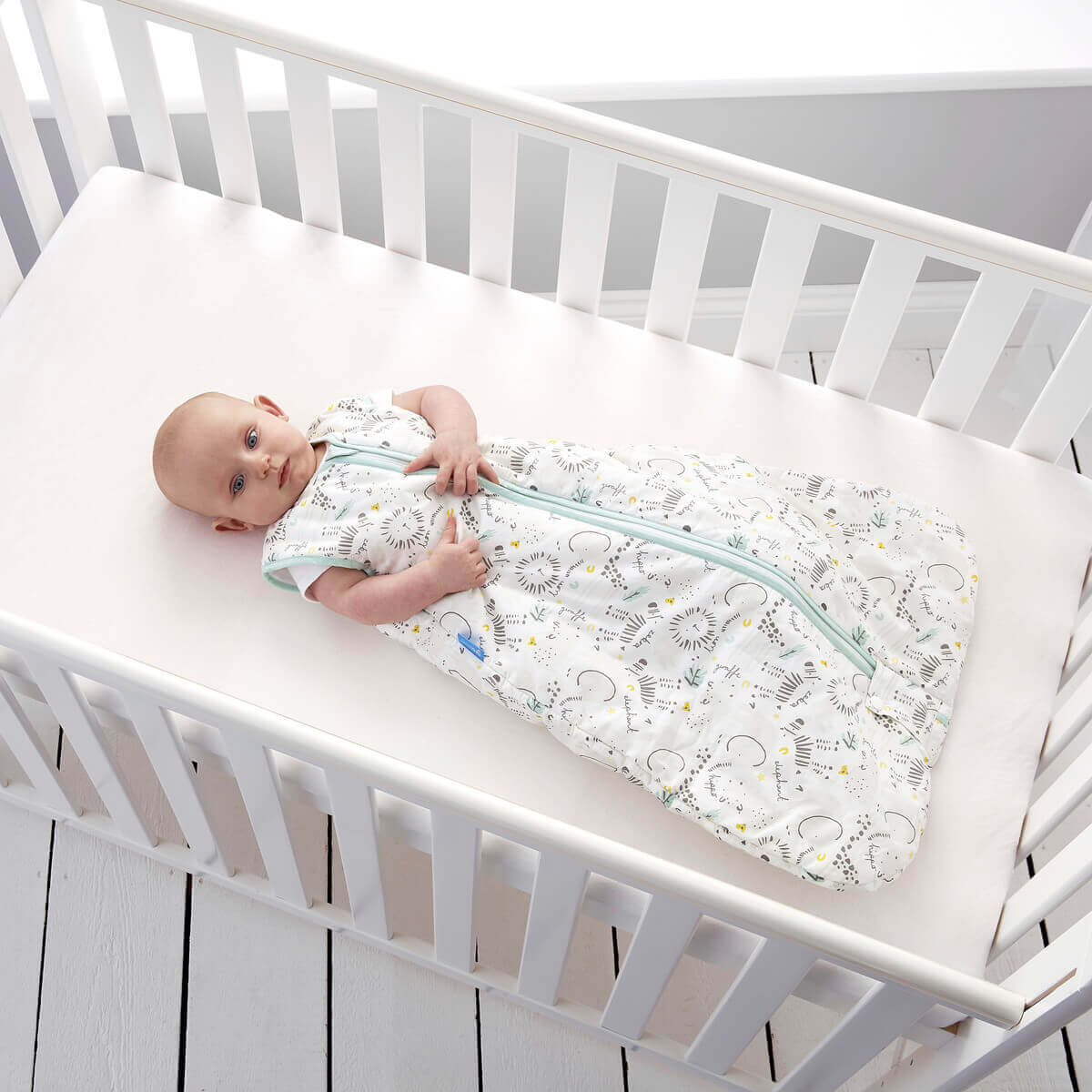 baby-lying-in-cot-wearing-jungle-boogie-grobag