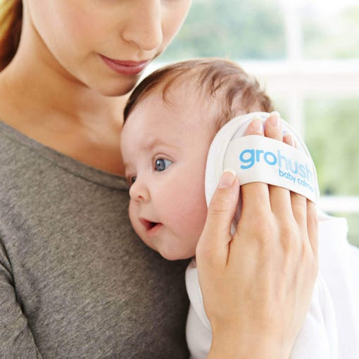 mum-holding-baby-with-grohush-against-babys-ear