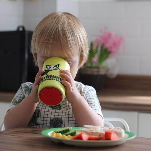 toddler-sitting-at-dinner-table-drinking-from-large-yellow-no-knock-cup-with-fox-design