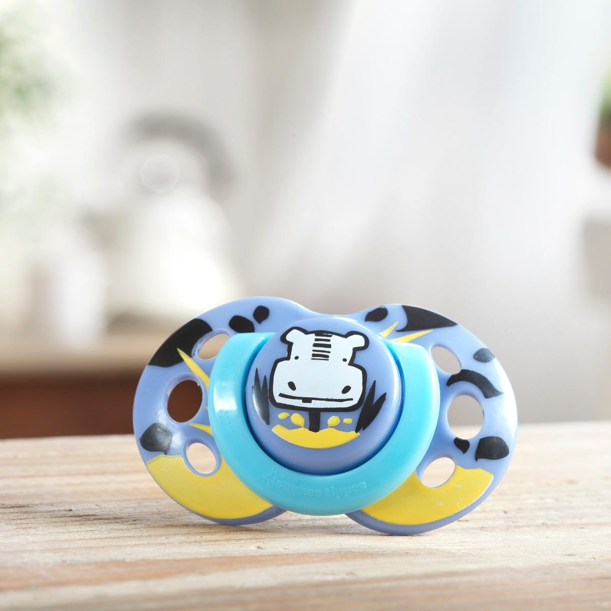 6-18-month-fun-style-hippo-soother-in-blue-on-counter-top