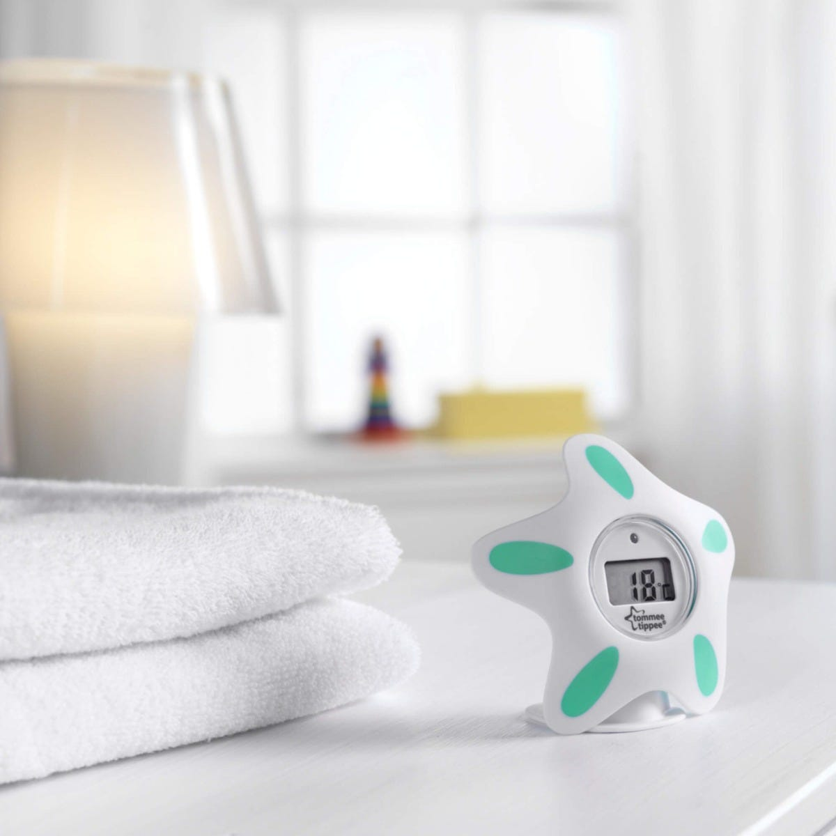 bath-and-room-thermometer-standing-on-ledge-in-bathroom