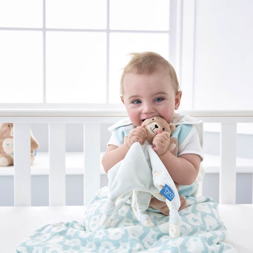 baby-chewing-bennie-the-bear-comforter-in-cot