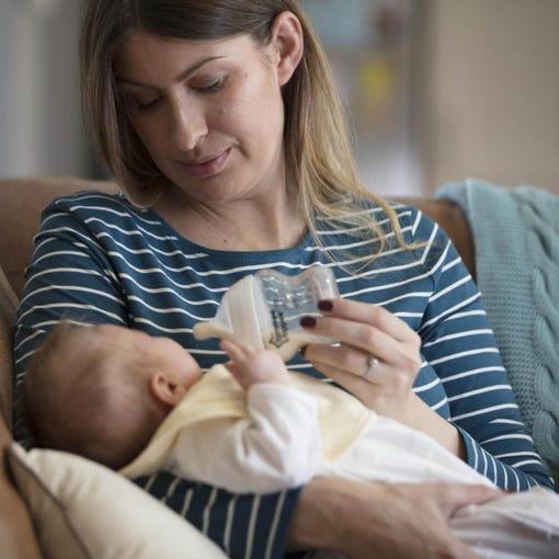 mum feeding baby with CTN bottle