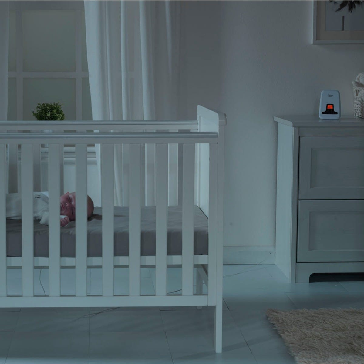 baby-sleeping-in-cot-in-nursery