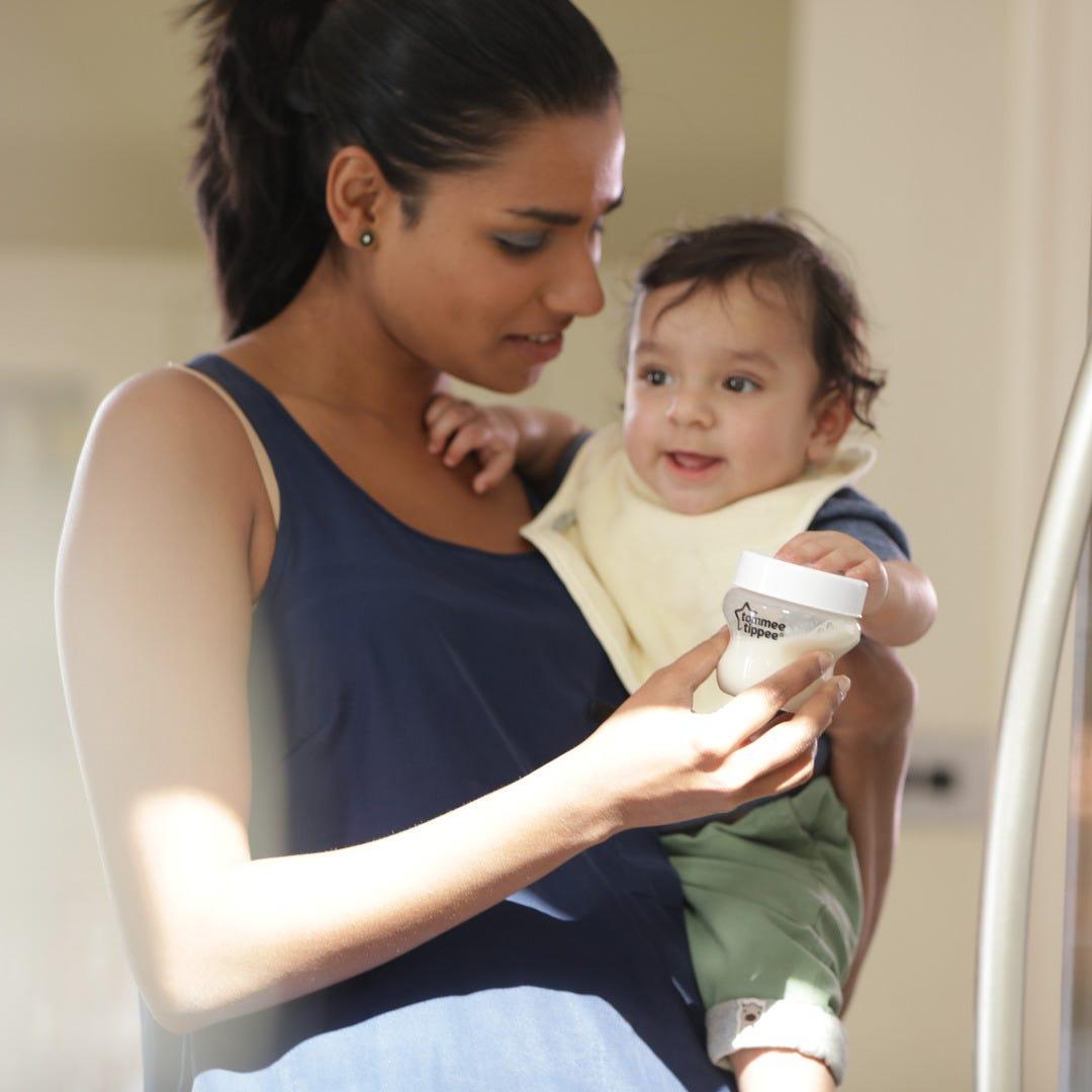 mum holding baby wearing cream comfi neck bib
