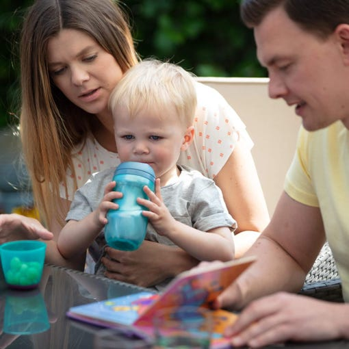 lifestyle-image-of-family-of-three-mum-holding-toddler-drinking-from-insulated-sippee-cup