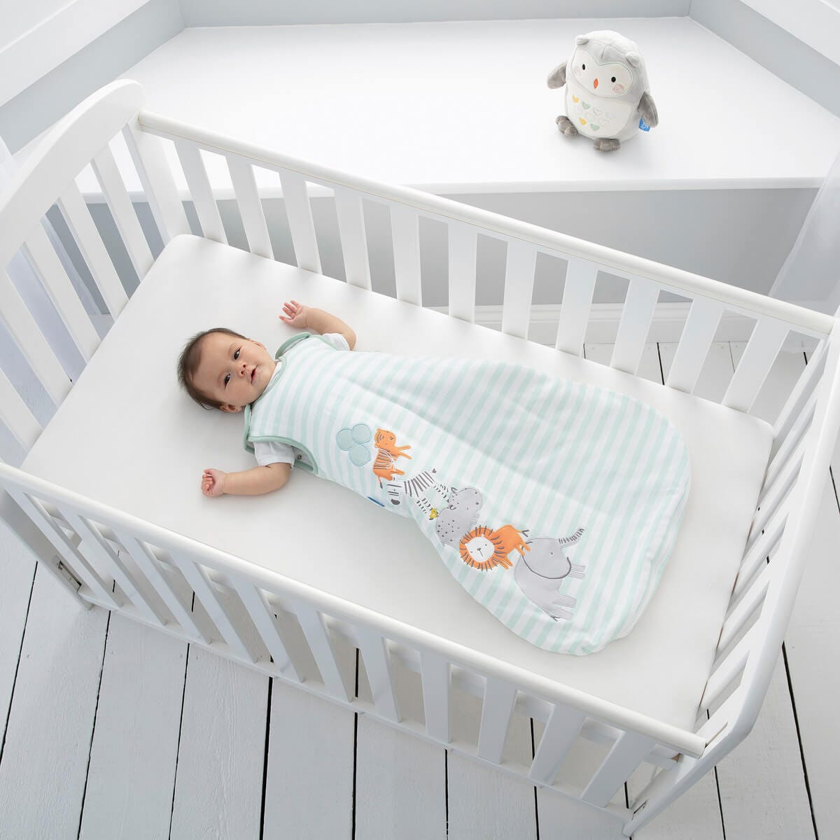 baby-lying-in-cot-wearing-jungle-stack-grobag