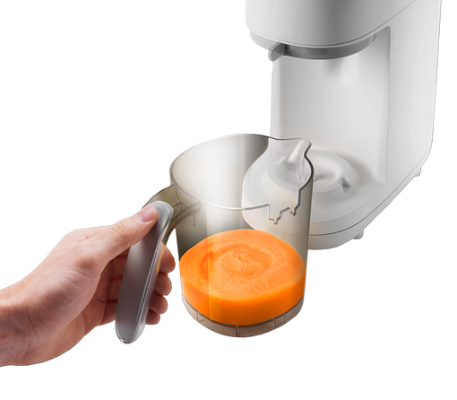 white-Quick-Cook-Baby-Food-Maker-showing-detachable-plastic-jug-with-spatula-handle-containing-steamed-and-blended-carrot-mix