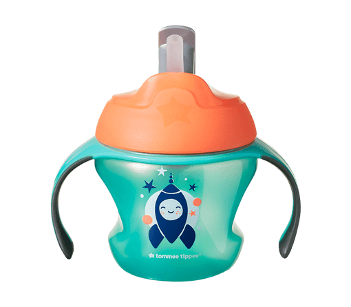 Green and orange Tommee Tippee First straw cup with rocket and stars on the front