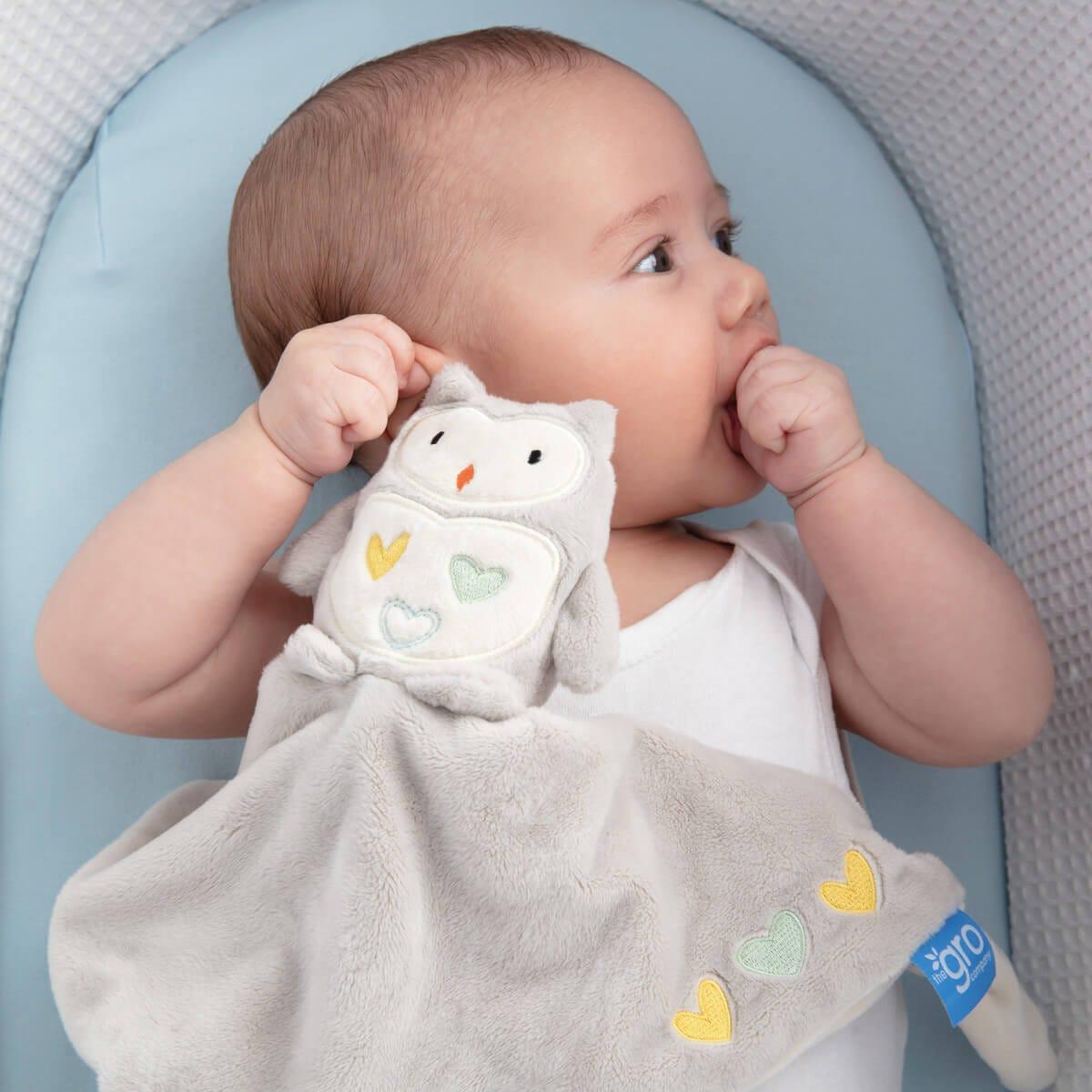 baby-in-sleepee-basket-holding-ollie-the-owl-grocomforter