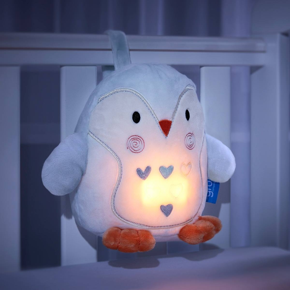 percy-penguin-grofriend-glowing-in-dark-attached-to-cot