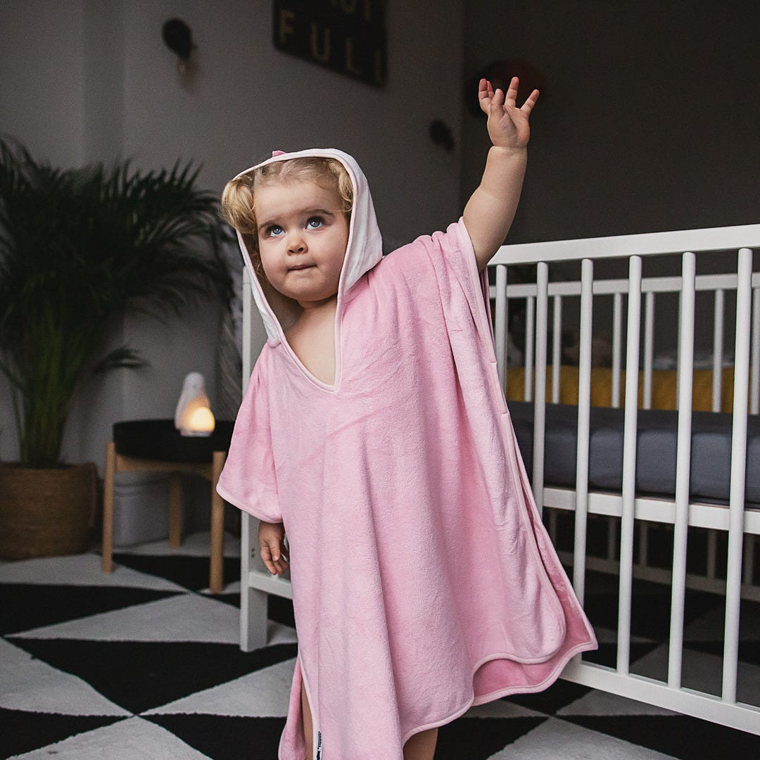 little-girl-standing-wearing-pink-penny-ponch-towel