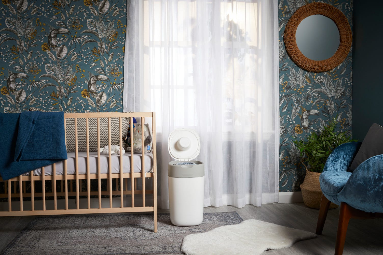baby-nursery-decoration-with-white-twist-and-click-in-front-of-window