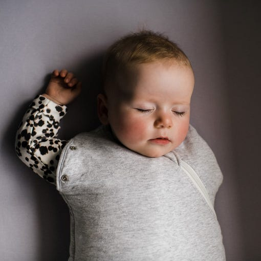 Baby wearing The Original Grobag Grey Marl Snuggle with one arm out