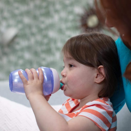 girl drinking from an active sports bottle