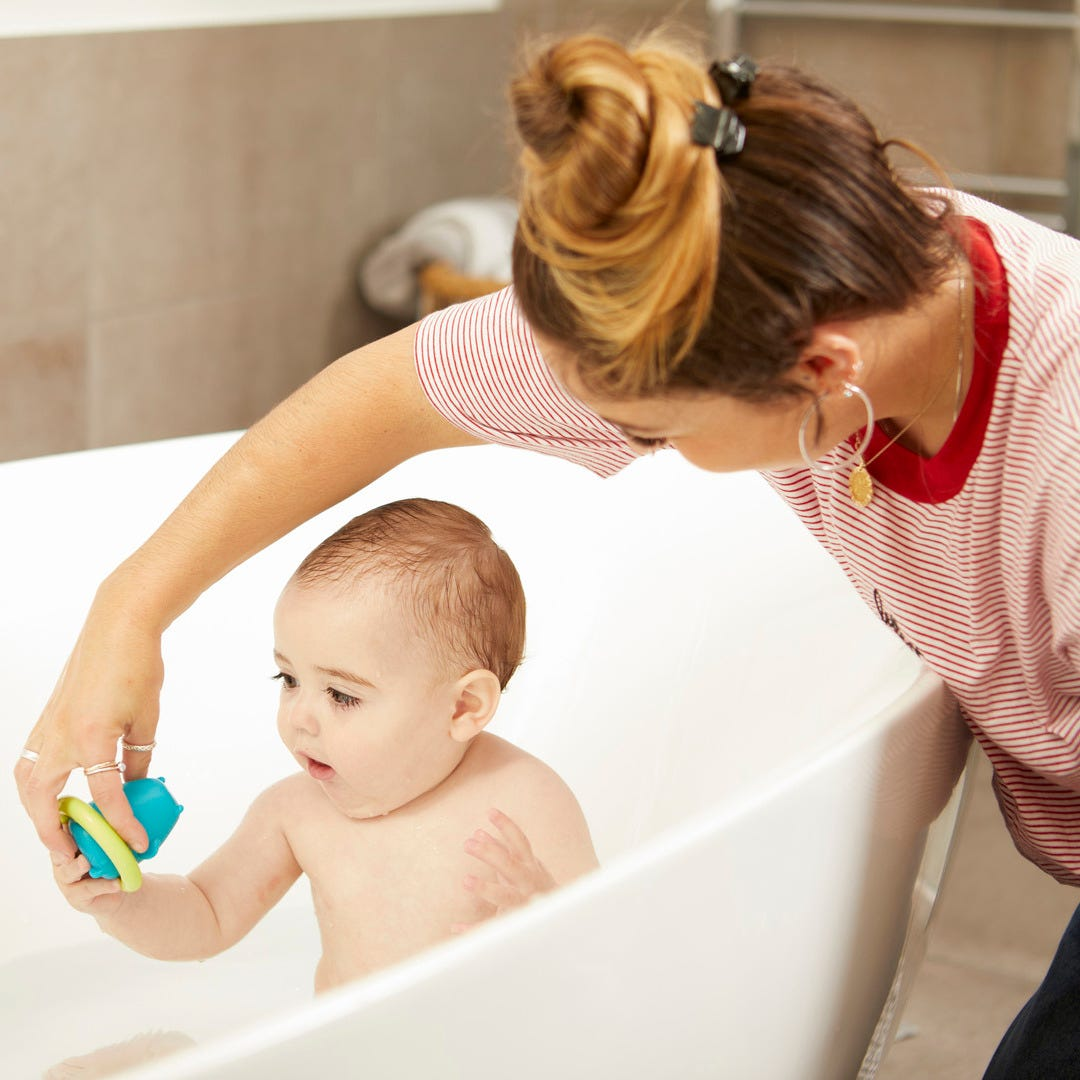 child playing with splashtime squirtee with mum