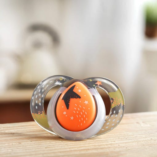 orange-star-soother-on-bench