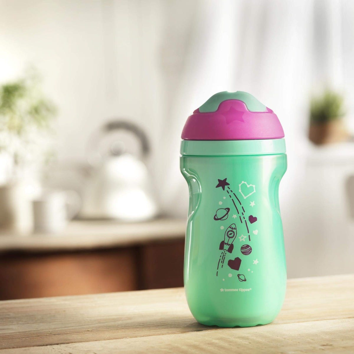 Insulated-sippee-cup-aqua-blue-with-pink-cap-and-rocket-planets-stars-design-on-kitchen-bench