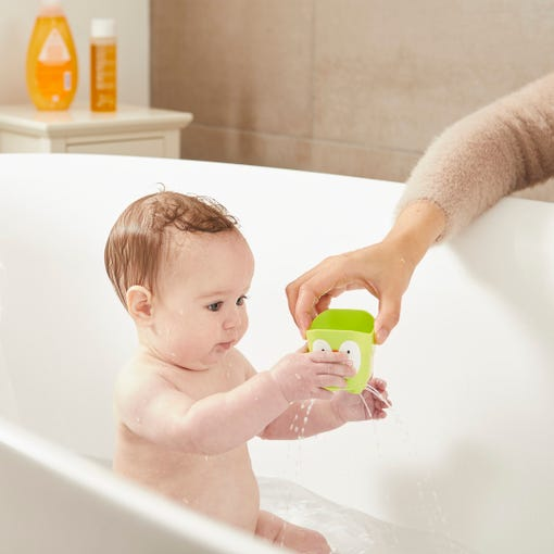 child playing with Splashtime Stack 'n' Pour bath cups