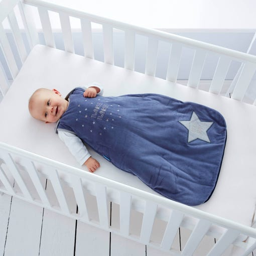 baby-lying-in-cot-smiling-wearing-twinkle-twinkle-grobag