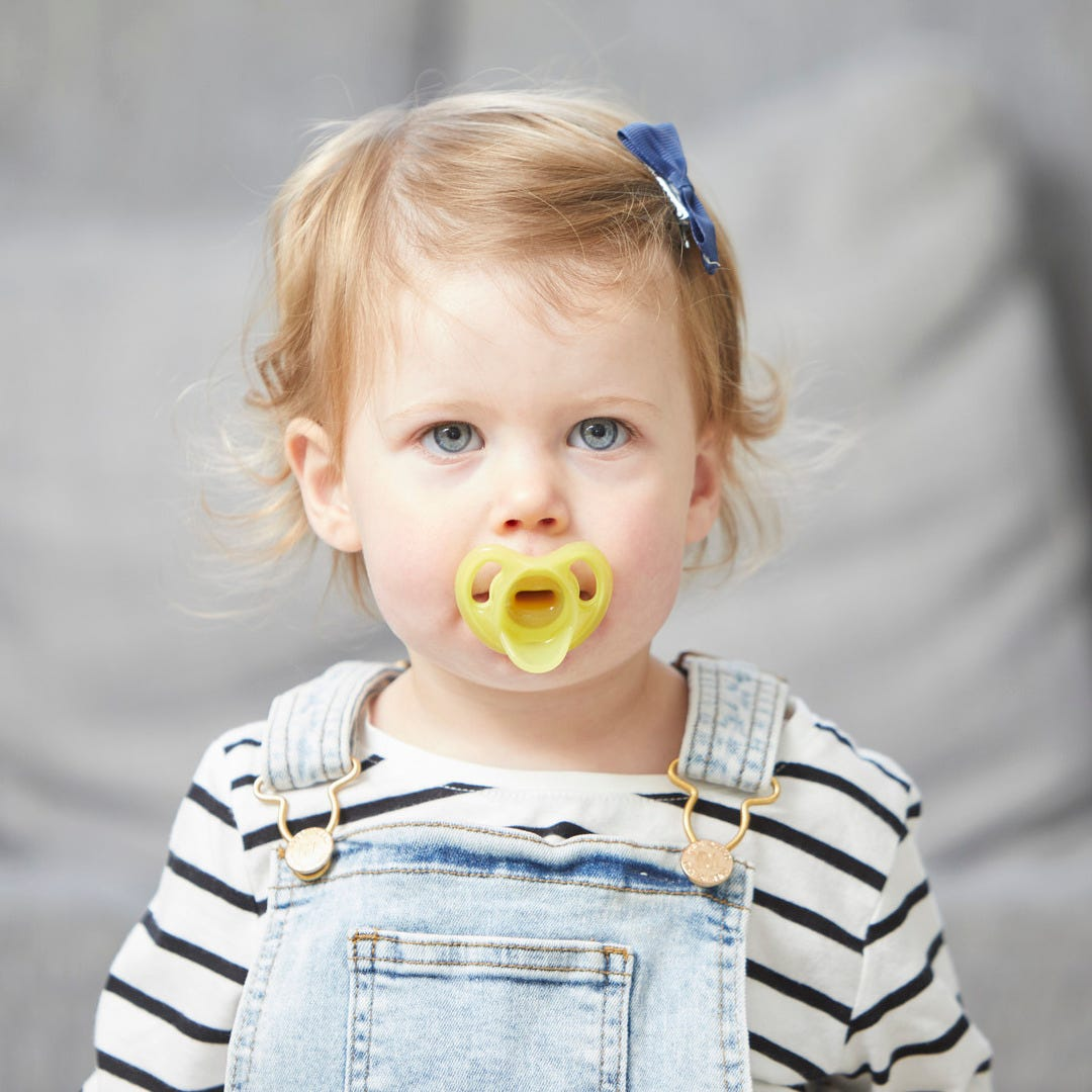 child with Ultra-light pacifier in mouth