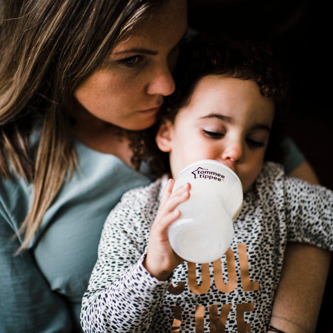 Girl feeding with CTN bottle