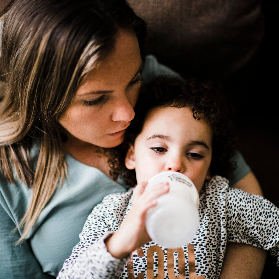 mum feeding baby with closer to nature baby bottle