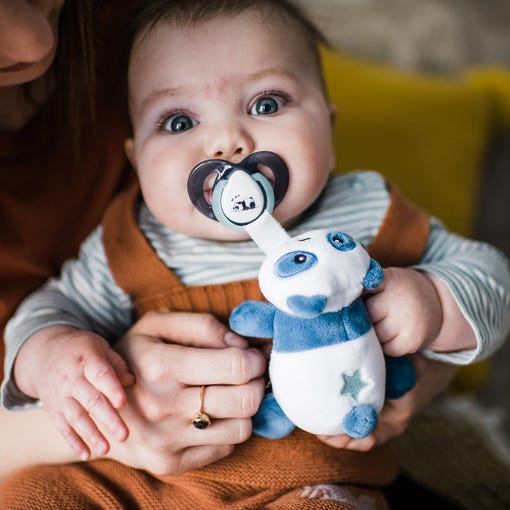 baby holding paci snuggie
